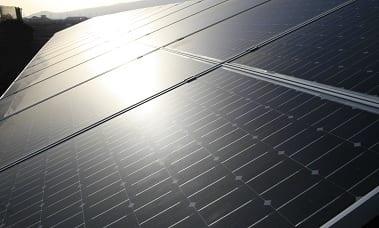 Solar Energy - Sun Shining on Solar Panels