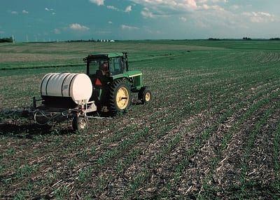 biogas waste converted into fertilizer - image of farm fertilizing