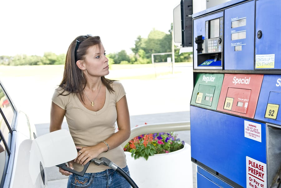 Hydrogen Fuel Station - Woman pumping gas