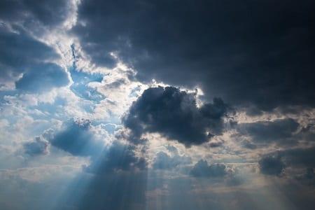 Solar Energy - Sun Behind Clouds