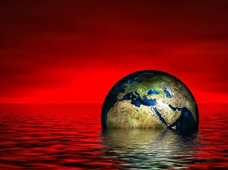Climate Change - Globe  sinking in water