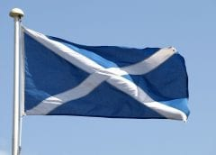 Scotland Wind Energy - Scottish flag blowing in wind