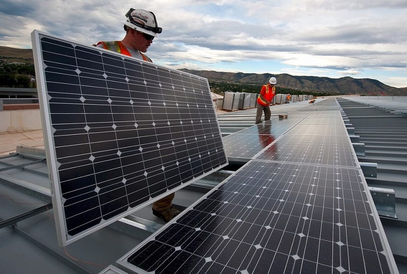 Solar Energy Industry - Solar panels being installed on rooftops