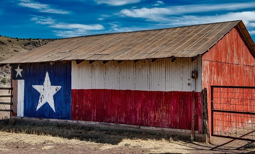 Clean Energy - Image of barn in Texas with flag