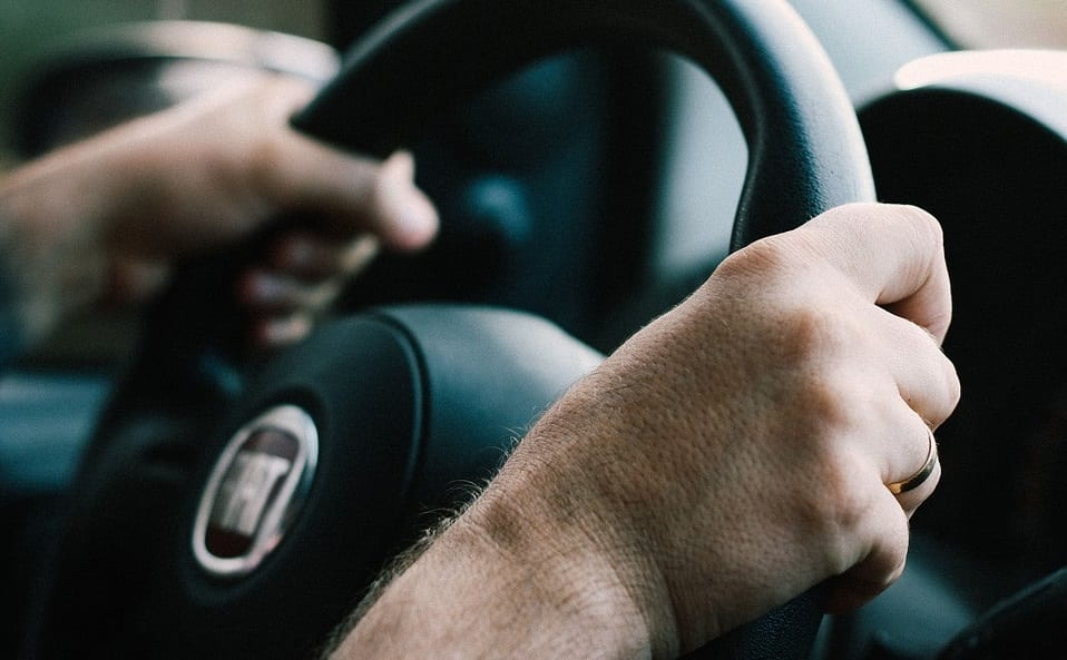 Electric Vehicles - driver holding steering wheel