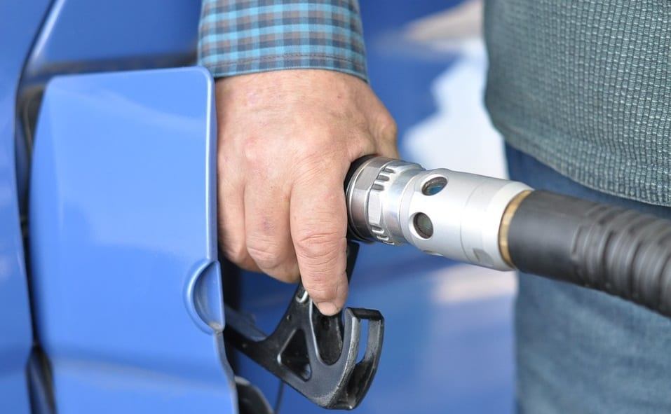 Hydrogen Fuel Stations - Man Refueling Car at gas station