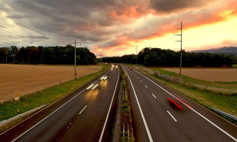 Fuel Cell Vehicles - Cars on Highway at Sunset