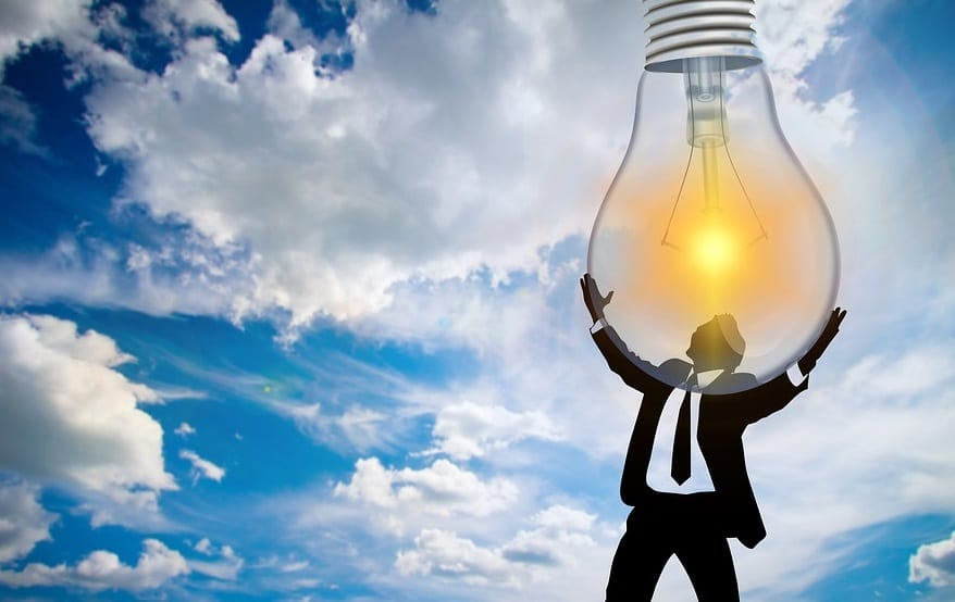 Renewable Energy Plan - Man holding lightbulb
