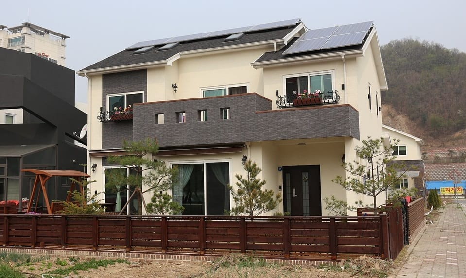 stored hydrogen and solar energy - home with solar panels on roof