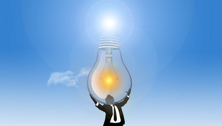Hydrogen production - Man holding lightbulb up to sun