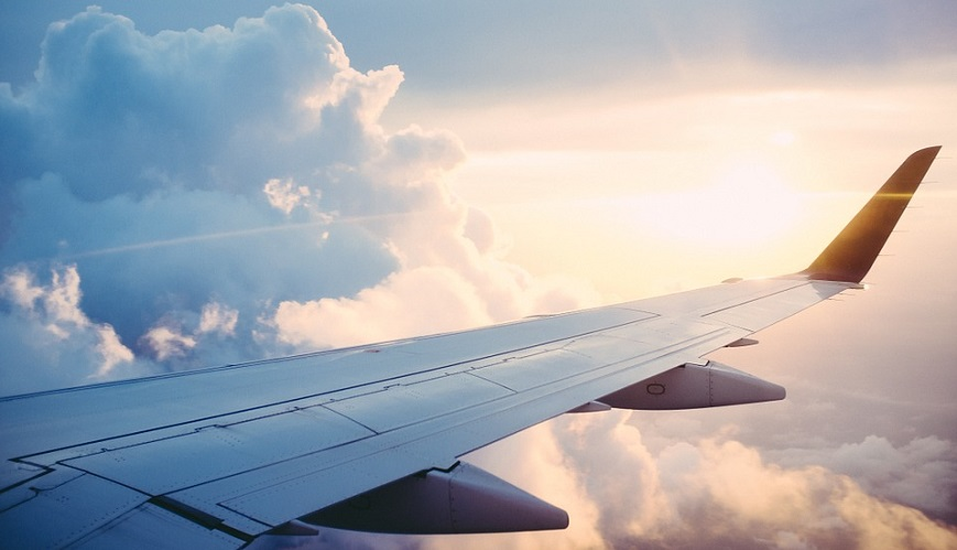Cryogenic liquid hydrogen - Wing of aircraft, sky, sun