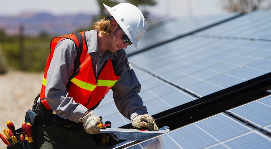 Renewable Energy Jobs - Man with solar panels