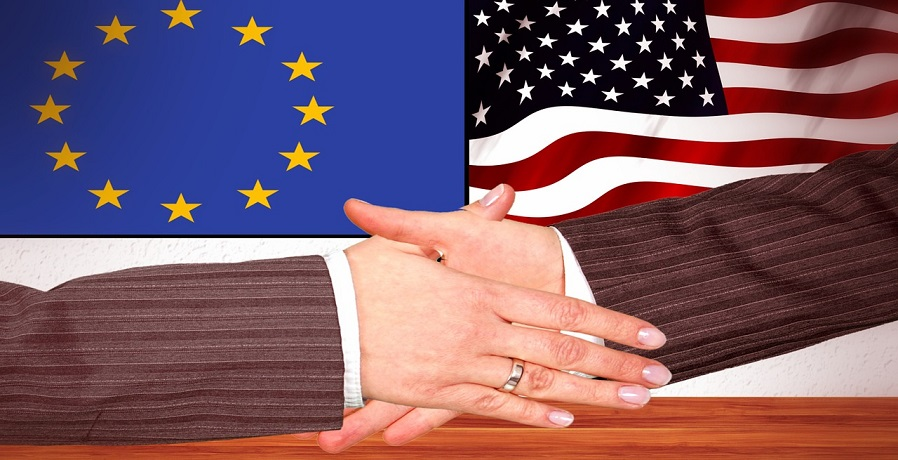 European Green Deal - Handshake - EU and American Flags