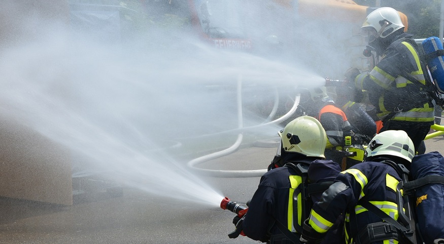 Hydrogen Fuel Cell Plant - Firefighters with hoses and water