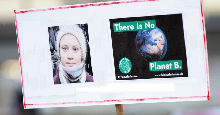 Climate change action - Greta Thunberg on climate activist sign
