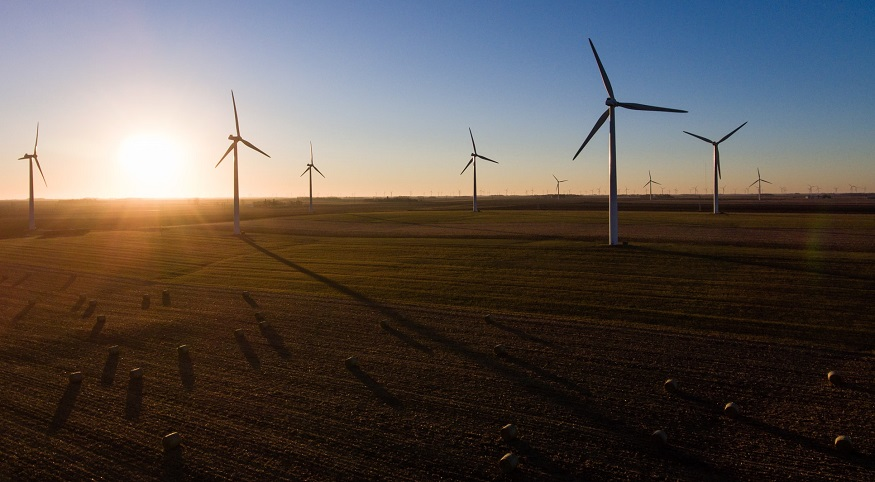 Clean energy solicitations - wind turbines at sunrise