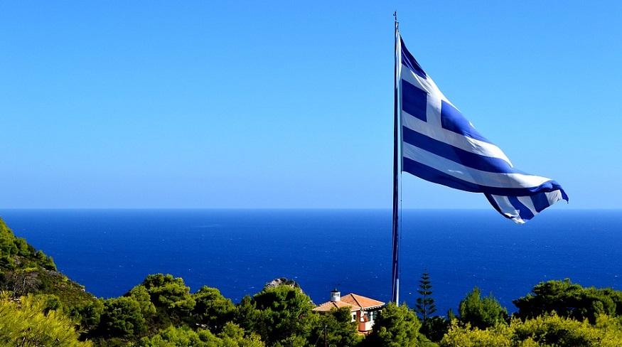 Green energy implementation - Greek Flag - Landscape in Greece