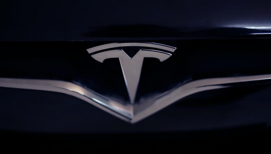 Tesla Shares - Tesla Logo on car