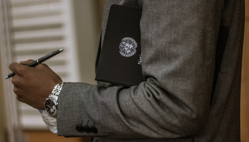 UN Sustainable Development Goals - Man holding folder with UN symbol