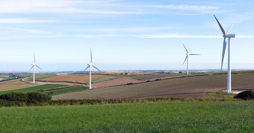 Wind turbine farms - wind turbines in field