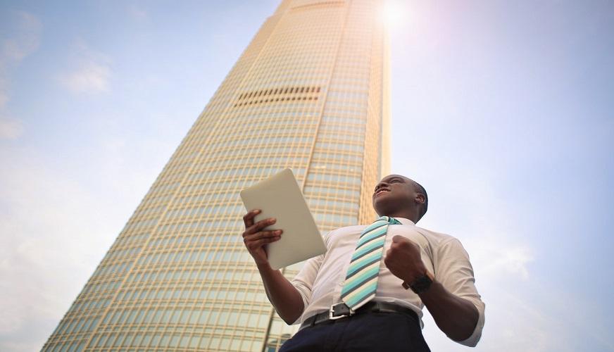 Solar to hydrogen - man celebrating success - building - sunshine