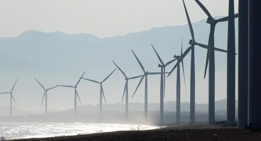 Taiwan renewable energy - wind turbine farm near beach