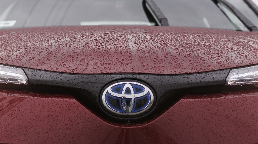 Fuel Cell Business Group - Toyota logo on car with water droplets