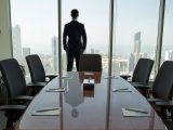 Nikola Motor Company - Man looking out window of office building