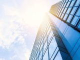 Solar Energy Company - Sun above skyscraper