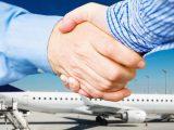 H2 storage - business partnership - handshake - airplane