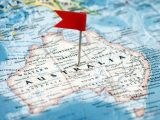 Green hydrogen production - Flag marking Australia on a map