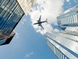 Hydrogen fuel aircraft - airplane above buildings