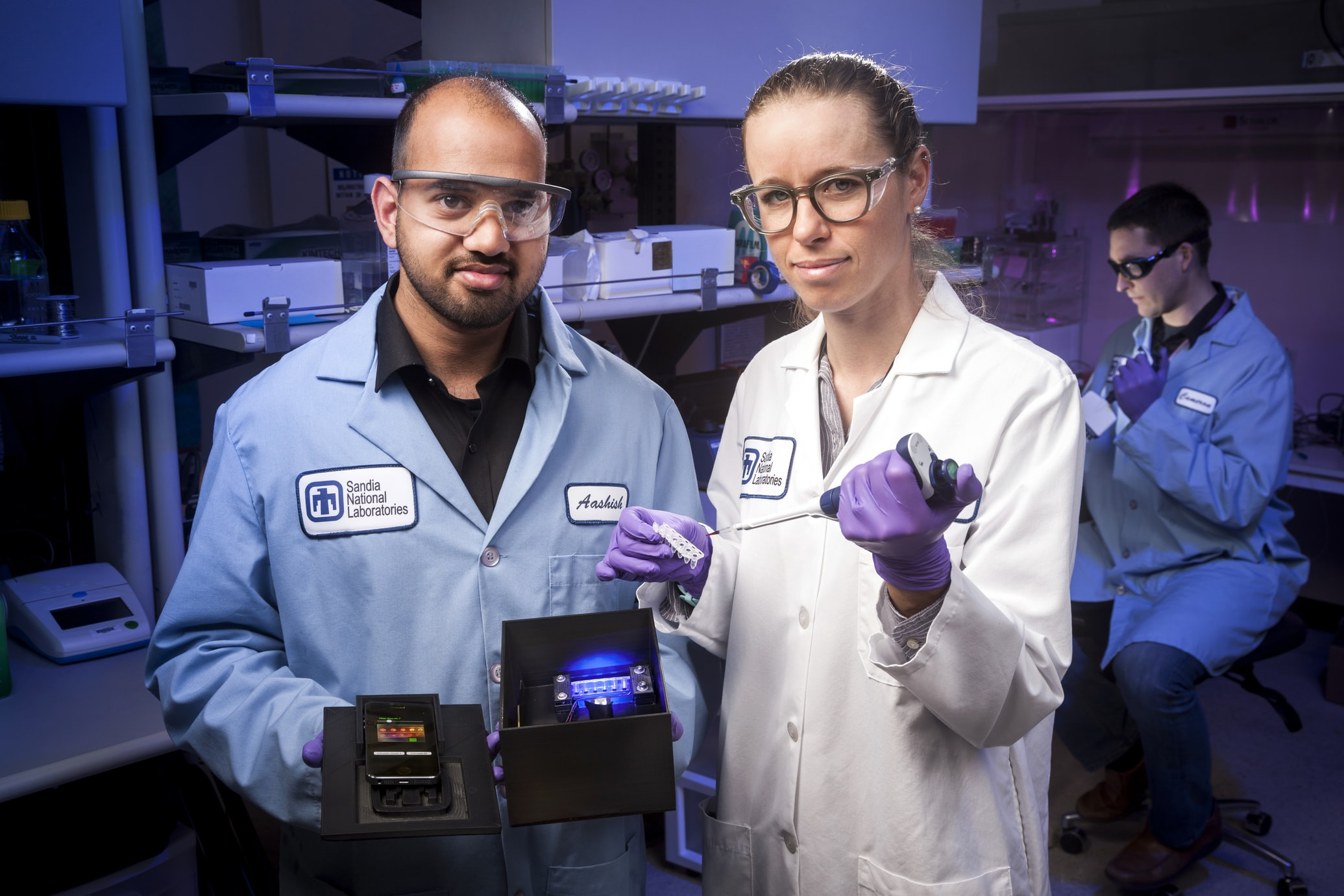 Hydrogen fuel research - image of sceintists wearing Sandia National Laboratories lab coats